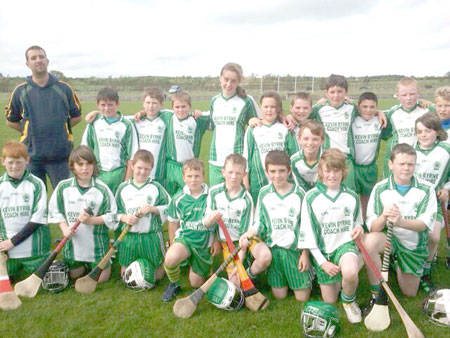 Aodh Ruadh under 12 hurlers with their manager Michael Ayres before their game against Ballycastle.