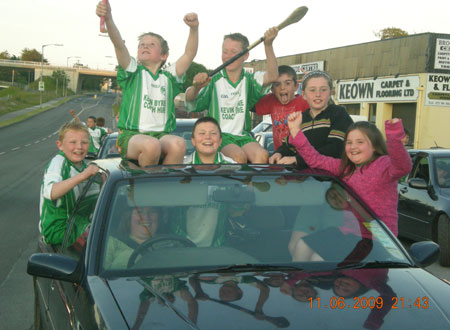 Aodh Ruadh players and supporters at the start of their victory cavalcade.