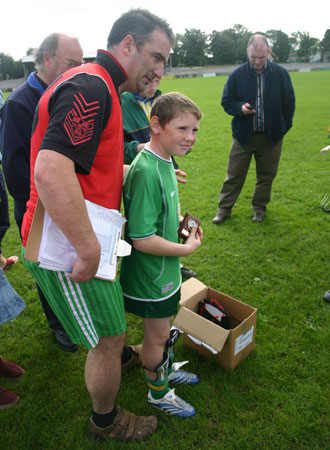 Winner of the under 12 skills tournament held on Sunday 23rd September in Father Tierney Park. Jamie Brennan with tournament organiser John Rooney.