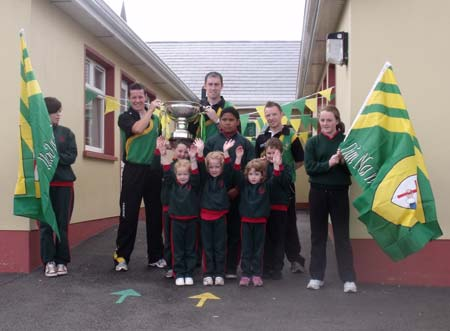 Students of Gaelscoil Eirne give the boys and Lory Meagher a great welcome.