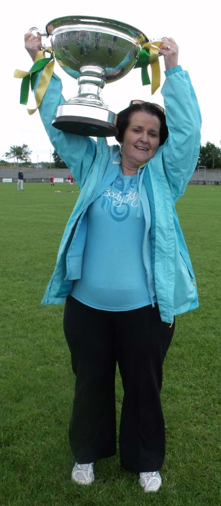 Breege Scott, Scoil Chatriona, hoists the Lory Meagher high.