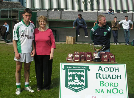 Mary Roper with the Aodh Ruadh captain, David Dolan, after the final of the PJ Roper under 16 tournament in Ballyshannon last Saturday. Brian Roper is to the right of the picture.