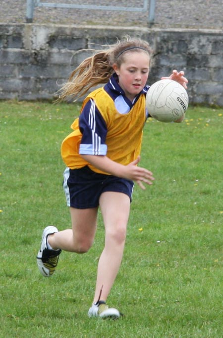 The underage girls footballers are put through their paces.